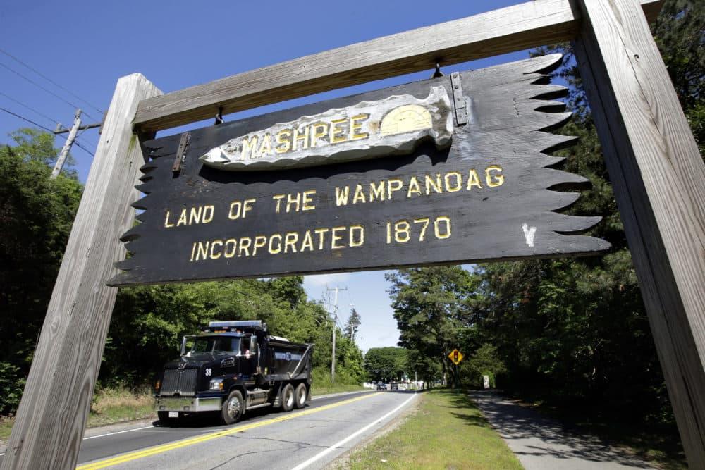A wooden sign advises motorists of the location of Mashpee Wampanoag tribal lands in Massachusetts. (Steven Senne/AP)