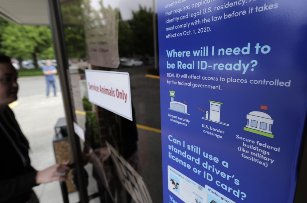 A sign provides information about the requirements of Real ID.  (Ted S. Warren/AP)