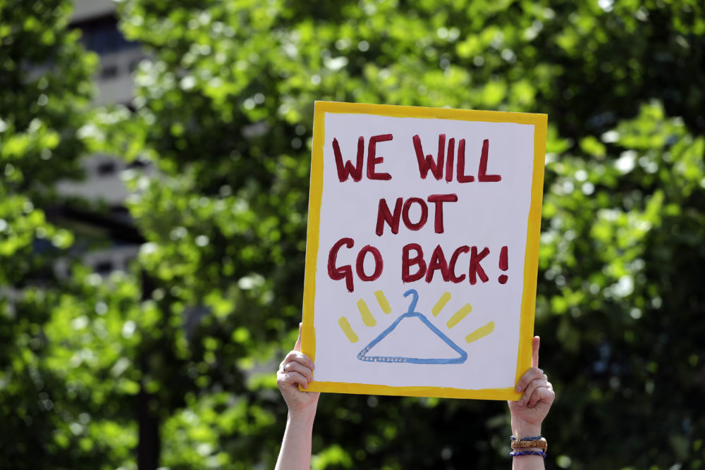 Abortion-rights supporters take part in a protest May 30, 2019, in St. Louis. A St. Louis judge heard an hour of arguments Thursday on Planned Parenthood's request for a temporary restraining order that would prohibit the state from allowing the license for Missouri's only abortion clinic to lapse at midnight Friday. (Jeff Roberson/AP)