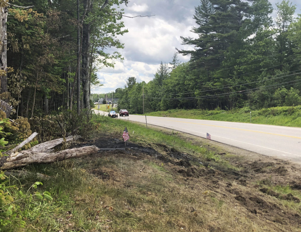 Tire marks are visible June 22, 2019, at the scene of a deadly crash involving motorcyclists with a club comprised of ex-United States Marines, who collided with a pickup truck on a rural highway in Randolph, N.H. (Michael Casey/AP)