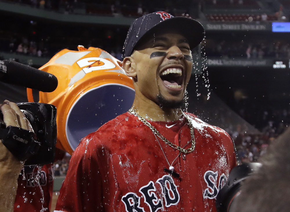 Boston Red Sox's Mookie Betts is doused after their victory over the New York Yankees in a baseball game at Fenway Park, Friday, July 26, 2019, in Boston. (Elise Amendola/AP)
