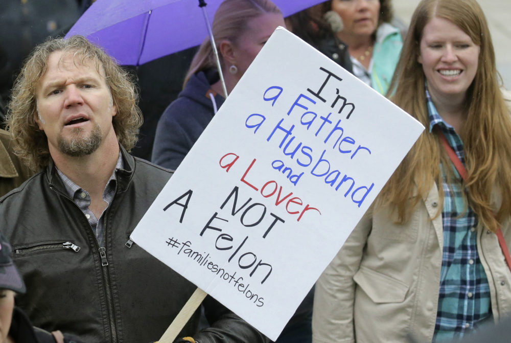 "Kody Brown from ""Sister Wives,"" a popular TV reality series about a polygamous family, marches during a protest at the state Capitol in Salt Lake City during 2017.(Rick Bowmer/AP)"
