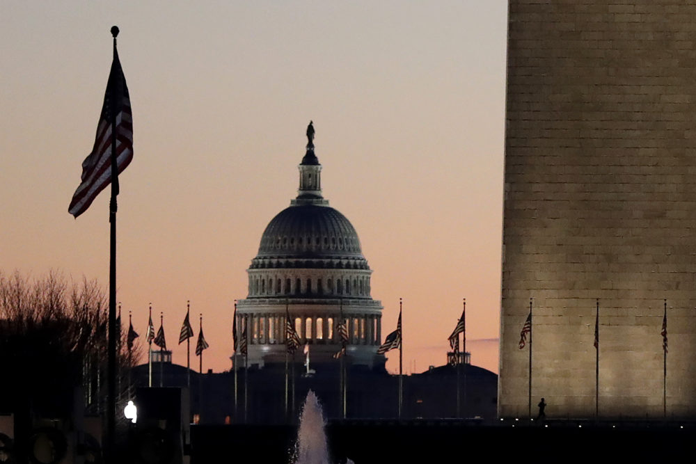 The U.S. Capitol building, center, and part of the Washington Monument, right, on Wednesday, Dec. 18, 2019, on Capitol Hill in Washington. (Julio Cortez/AP)