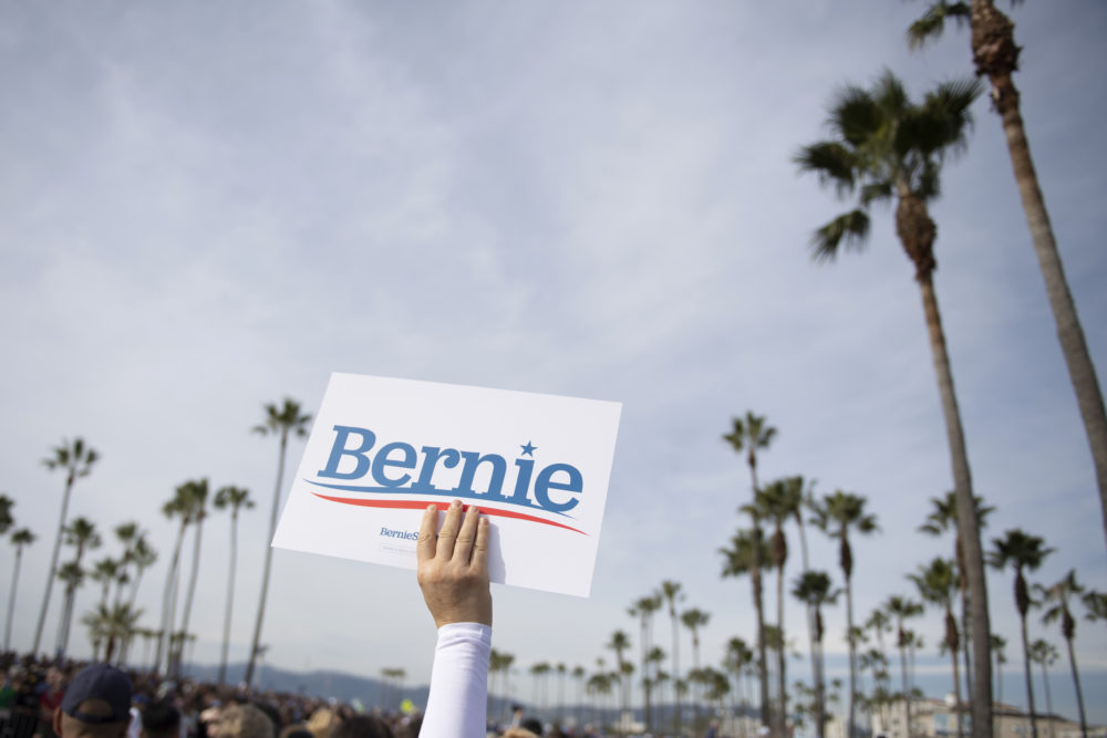 In this Dec. 21, 2019, file photo, a supporter holds up a sign for Democratic presidential candidate Sen. Bernie Sanders, I-Vt., during a rally in Venice, Calif. (Kelvin Kuo/AP)