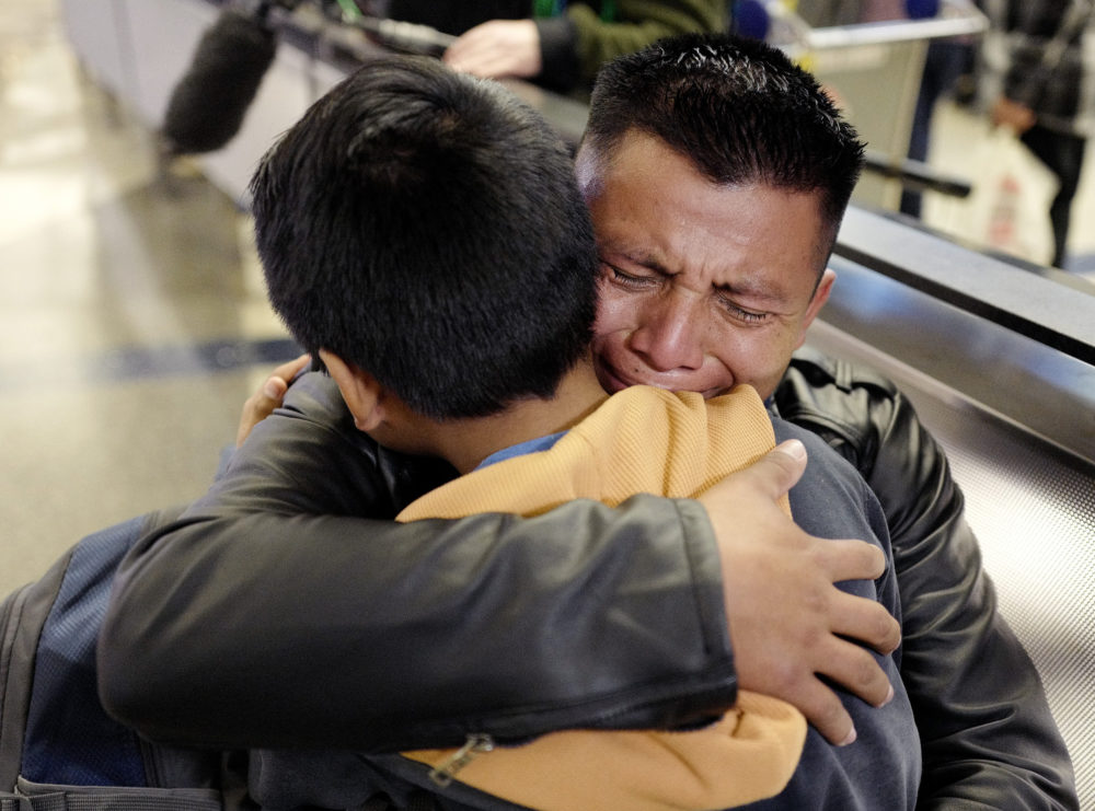 David Xol-Cholom, of Guatemala hugs his son Byron at Los Angeles International Airport as they reunite after being separated about one and half years ago during the Trump administration's wide-scale separation of immigrant families, Wednesday, Jan. 22, 2020, in Los Angeles. (Ringo H.W. Chiu/AP)