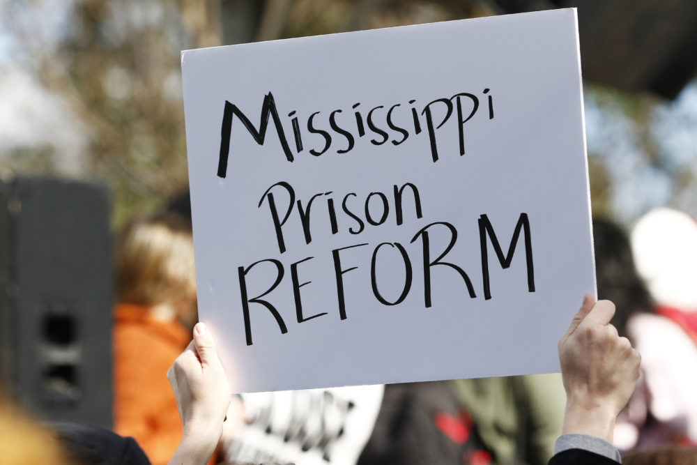 Several attendees waved handmade posters calling for help for the inmates during a mass rally in front of the Mississippi Capitol in Jackson, Miss., Friday, Jan. 24, 2020, protesting conditions in prisons where inmates have been killed in violent clashes in recent weeks. (Rogelio V. Solis/AP)