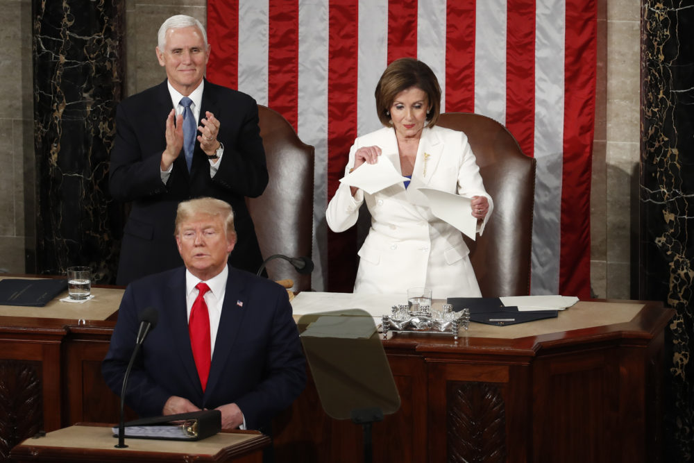 House Speaker Nancy Pelosi of Calif., tears her copy of President Donald Trump's s State of the Union address after he delivered it to a joint session of Congress on Capitol Hill in Washington, Tuesday, Feb. 4, 2020. Vice President Mike Pence is at left. (Alex Brandon/AP)