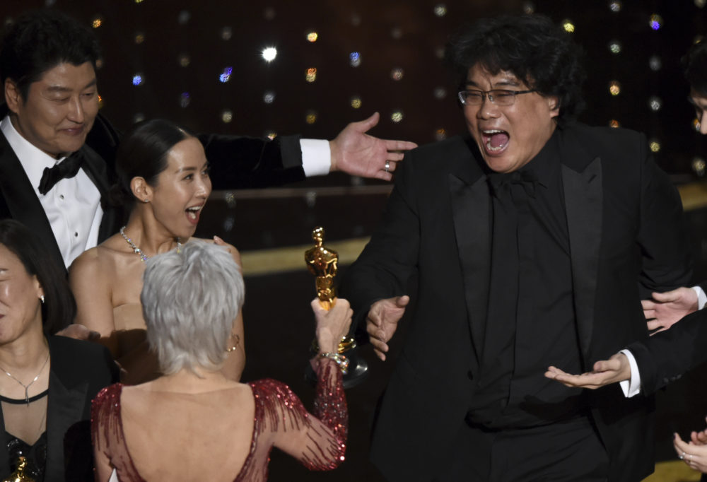 "Bong Joon Ho, right, reacts as he is presented with the award for best picture for ""Parasite"" at the Oscars on Sunday. (AP/Chris Pizzello)"