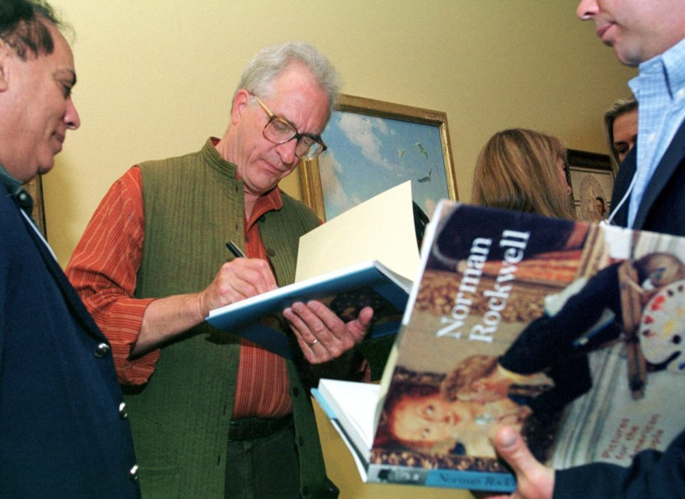 In this June 7, 2001 file photo, Peter Rockwell autographs a book  at The Rockwell Museum in Stockbridge, Mass.  (AP Photo/Nancy Palmieri, File)