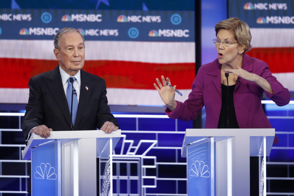Democratic presidential candidates, former New York City Mayor Mike Bloomberg, left, listens as Sen. Elizabeth Warren, D-Mass., speak during a Democratic presidential primary debate Wednesday, Feb. 19, 2020, in Las Vegas. (John Locher/AP)