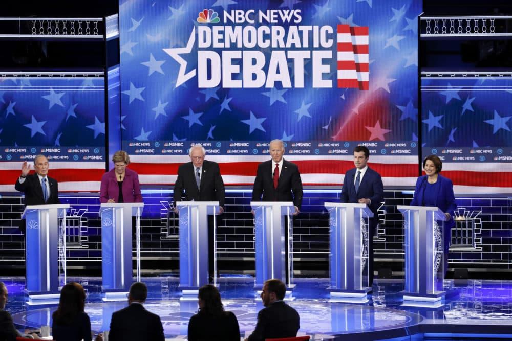 From left, Democratic presidential candidates, Mike Bloomberg, Elizabeth Warren, Bernie Sanders, Joe Biden, Pete Buttigieg and Amy Klobuchar participate in a Democratic presidential primary debate Feb. 19, 2020, in Las Vegas. (John Locher/AP)