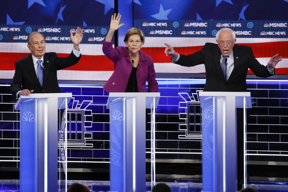 From left, Democratic presidential candidates, former New York City Mayor Mike Bloomberg, Sen. Elizabeth Warren, D-Mass., Sen. Bernie Sanders, I-Vt., participate in a Democratic presidential primary debate Wednesday, Feb. 19, 2020, in Las Vegas, hosted by NBC News and MSNBC. (John Locher/AP)