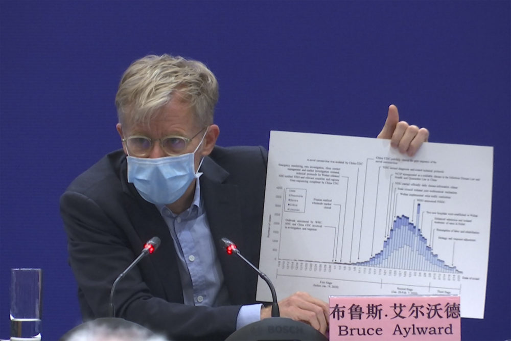 Bruce Aylward, an assistant director-general of the World Health Organization speaks with a chart during a press conference in Beijing on Monday, Feb. 24, 2020. Aylward said in Beijing on Monday that China's actions had probably prevented tens of thousands and possibly hundreds of thousands of cases of ther COVID-19 virus. (Sam McNeil/AP)