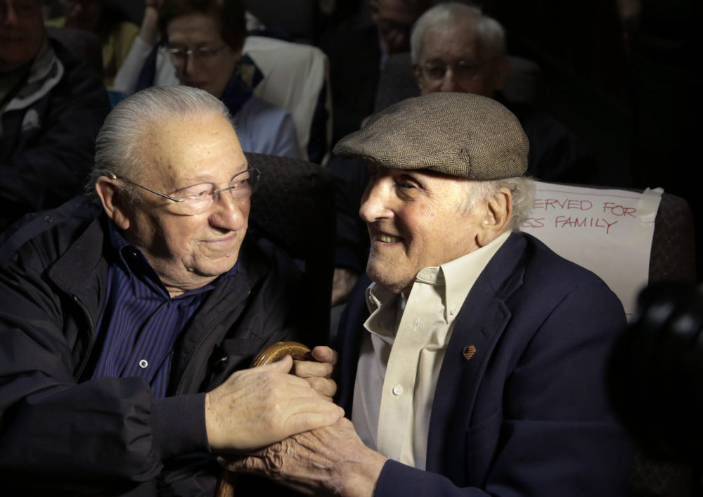 """Holocaust survivors Israel Arbeiter, left, and Steve Ross greet one another at a theater before the 2017 premier of the film """"Etched in Glass: The Legacy of Steve Ross,"""" in West Newton, Mass. Ross, a Holocaust survivor who spent decades searching for the soldier who helped him at a concentration camp in 1945, died Monday.  (Steven Senne/AP File Photo)"""