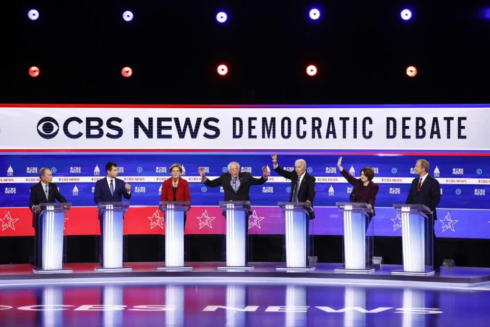 From left, Democratic presidential candidates, Mike Bloomberg, Pete Buttigieg, Elizabeth Warren, Bernie Sanders,Joe Biden, Amy Klobuchar and Tom Steyer, participate in a Democratic presidential primary debate in Charleston, S.C. (Patrick Semansky/AP)