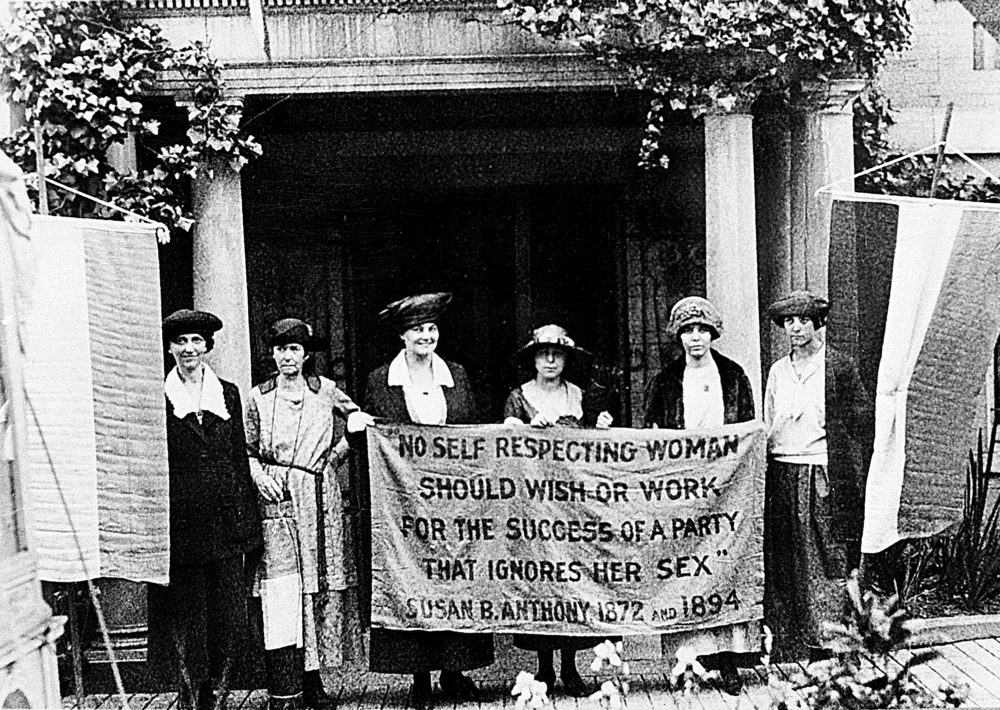 Chairwoman Alice Paul, second from left, and officers of the National Woman's Party hold a banner with a Susan B. Anthony quote in front of the NWP headquarters in Washington, D.C., June 1920.  The suffragettes are ready for the G.O.P. convention to seek support for the ratification of the 19th Amendment granting women the right to vote.  (AP Photo)
