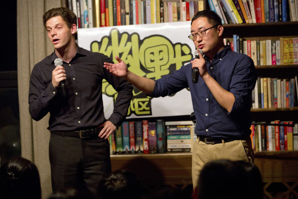 American Jesse Appell (left) is a former Fulbright Scholar who studied comedy in China as a disciple of Chinese Xiangsheng master Ding Guangquan. (Mark Schiefelbein/AP)