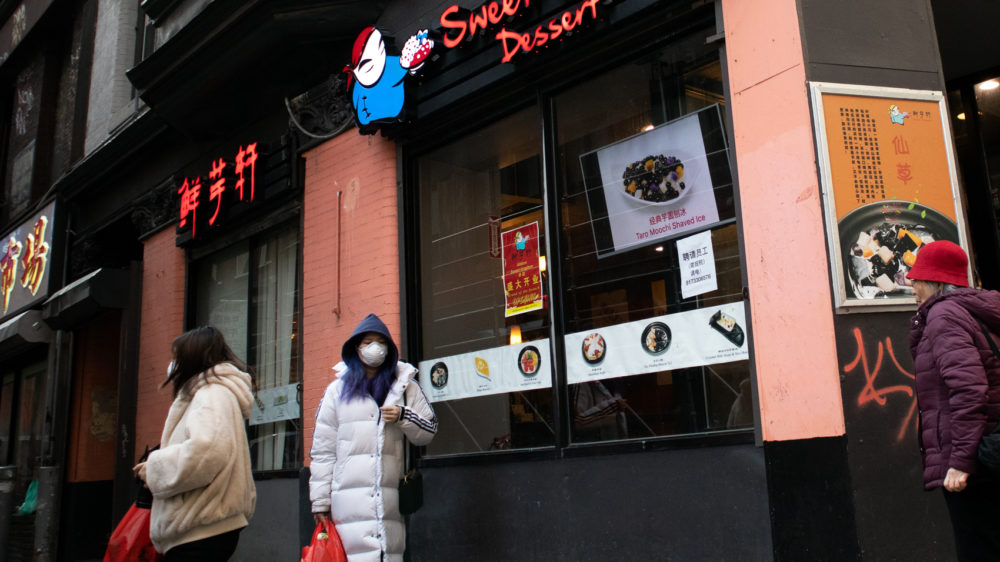 On a recent afternoon in Chinatown, it was not uncommon to see people wearing face masks. (Adrian Ma/WBUR)