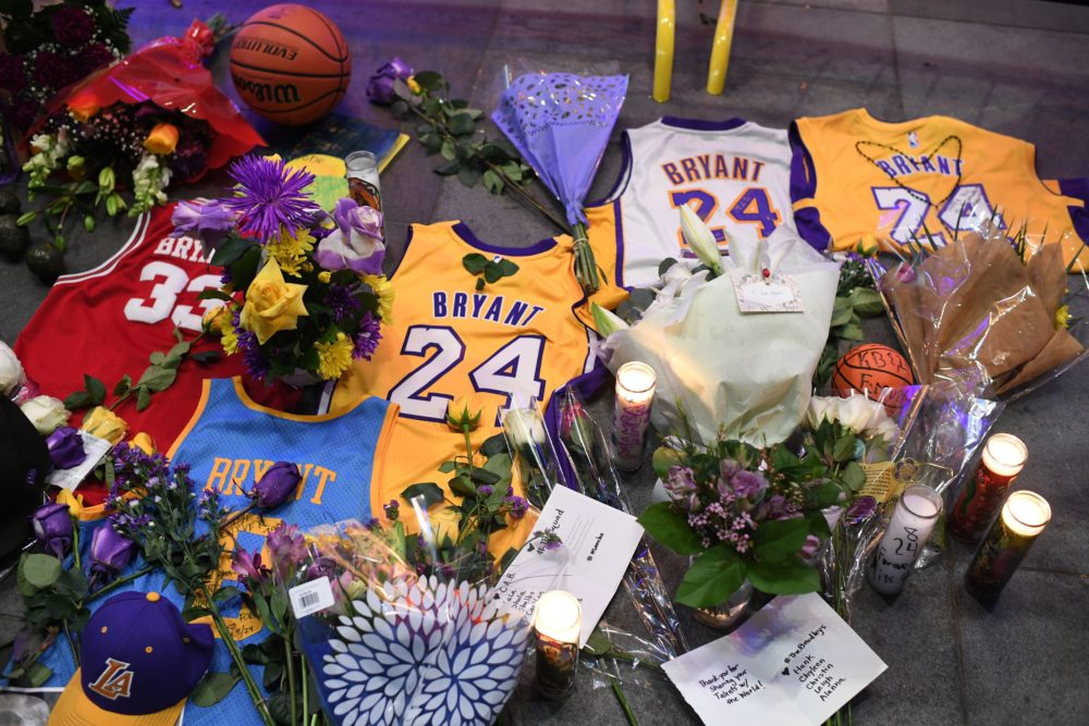 Jerseys, flowers and candles are placed at a makeshift memorial as fans mourn the death of NBA legend Kobe Bryant. (Robyn Beck/AFP via Getty Images)