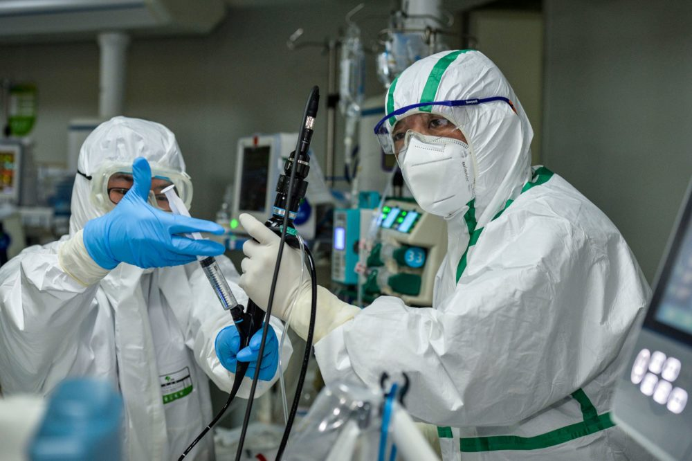 We discuss why thousands of health care workers in China seem to be bearing the brunt of the coronavirus. (STR/AFP via Getty Images)