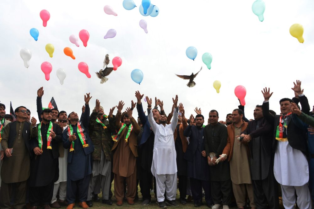 Youth release balloons and pigeons as they celebrate the reduction in violence, in Jalalabad on February 28, 2020. (NOORULLAH SHIRZADA/AFP via Getty Images)