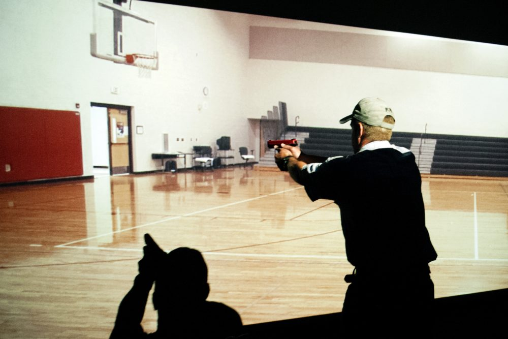 A trainee takes part in a simulated active shooter drill during a three day firearms course for school teachers and administrators. (Jason Connolly/AFP/Getty Images)