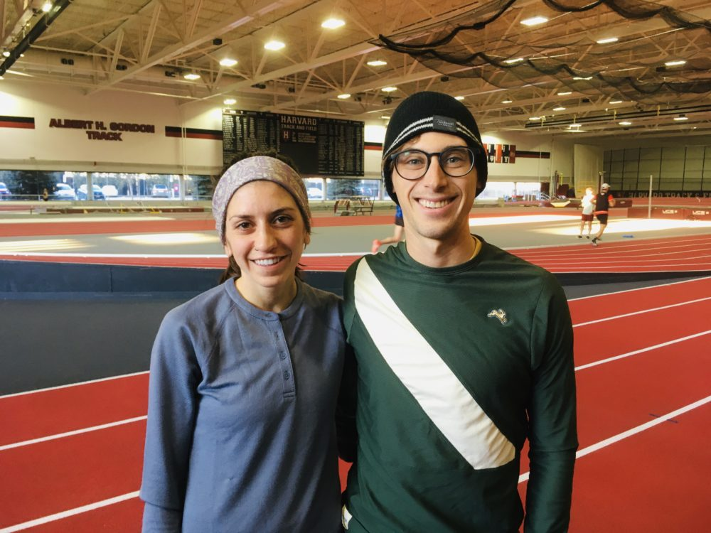 Lou Serafini poses with Gabi Drummond at Harvard's Gordon Indoor Track. Both will be running in the Olympic Marathon Trials in Atlanta. (Alex Ashlock/WBUR)