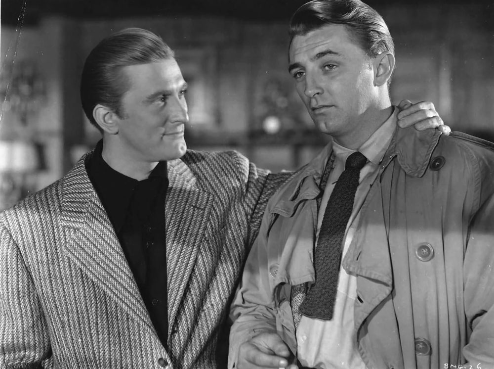 "Kirk Douglas, left, with Robert Mitchum in a still from the film ""Out of the Past."" (Courtesy the Brattle Theatre)"