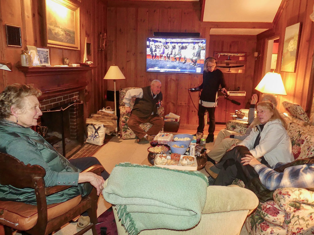 Host Robin Young interviews five neighbors gathered to watch the Democratic debate Friday night. (Karyn Miller-Medzon/Here & Now)