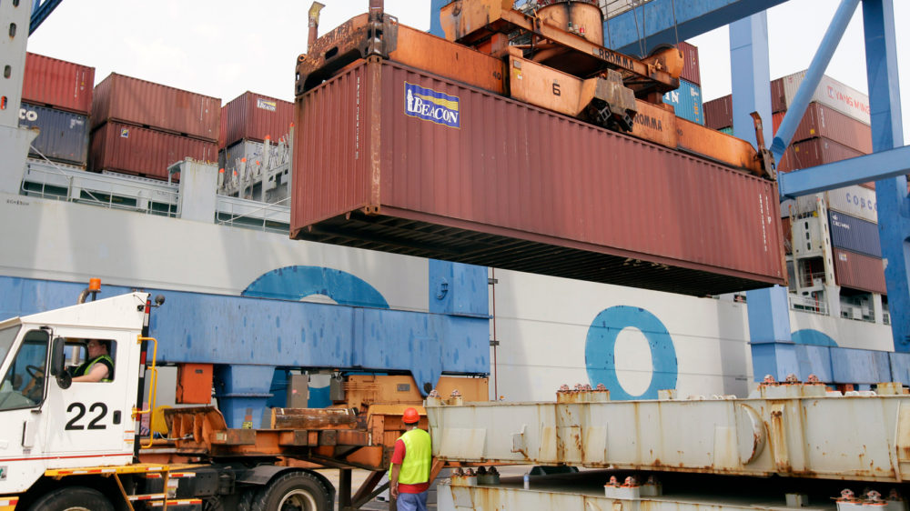 A container is loaded onto a ship from China at Massport's Conley Terminal in the port of Boston. (Stephan Savoia/AP)