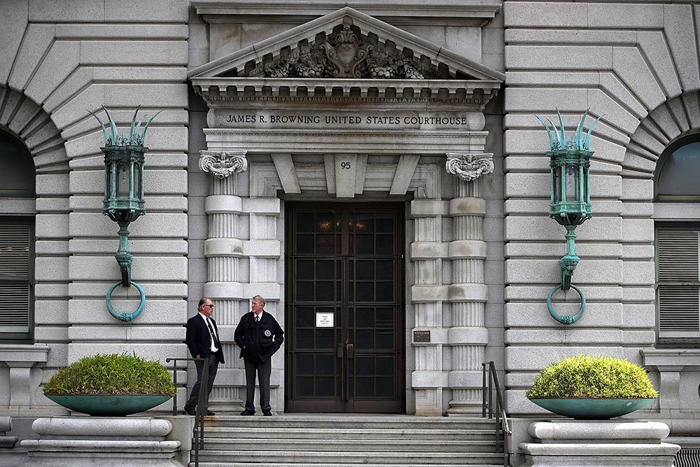 Security guards stand in front of the Ninth U.S. Circuit Court of Appeals  on June 12, 2017 in San Francisco, California. (Justin Sullivan/Getty Images)