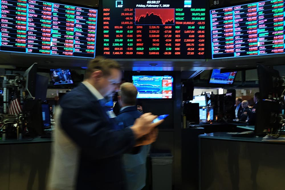 Traders work on the floor of the New York Stock Exchange (NYSE) on February 07, 2020 in New York City. As concern continues over the global economic impact from the Coronavirus, stocks fells over 200 points.  (Spencer Platt/Getty Images)