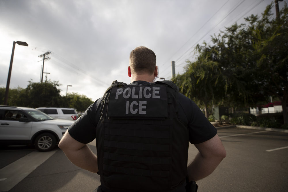 In this July 8, 2019, file photo, a U.S. Immigration and Customs Enforcement (ICE) officer looks on during an operation in Escondido, Calif. (Gregory Bull/AP)