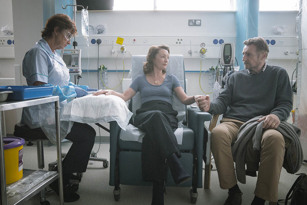"Lesley Manville (center) and Liam Neeson (right) in ""Ordinary Love."" (Aidan Monaghan/Bleecker Street)"