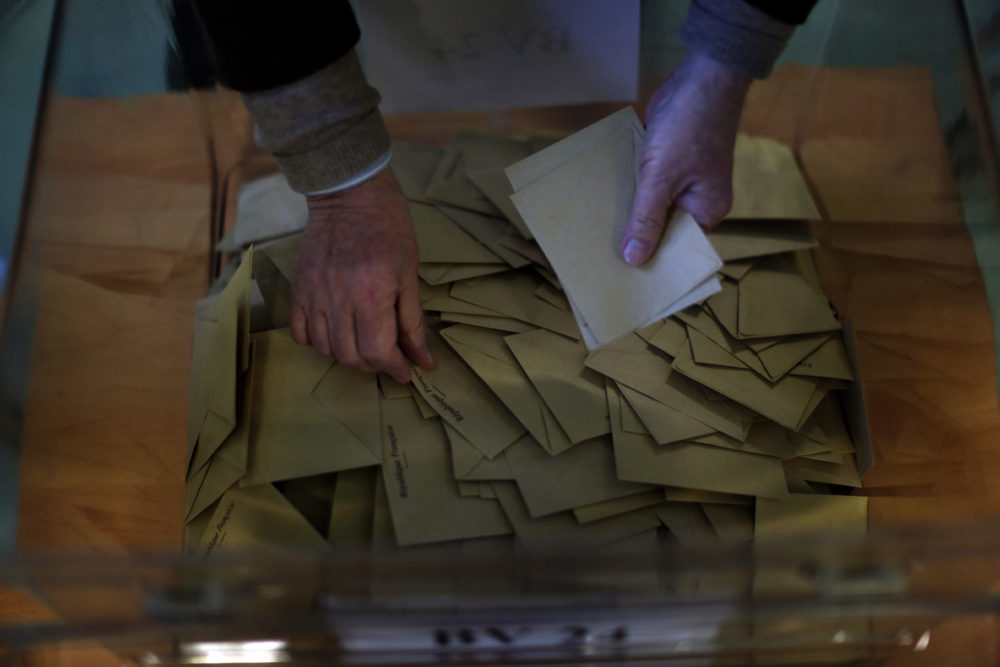 Ballots are counted by an election official for the 2017 presidential election at a polling station in Paris, The election was seen as a test for the spread of populism around the world. (Emilio Morenatti/AP)