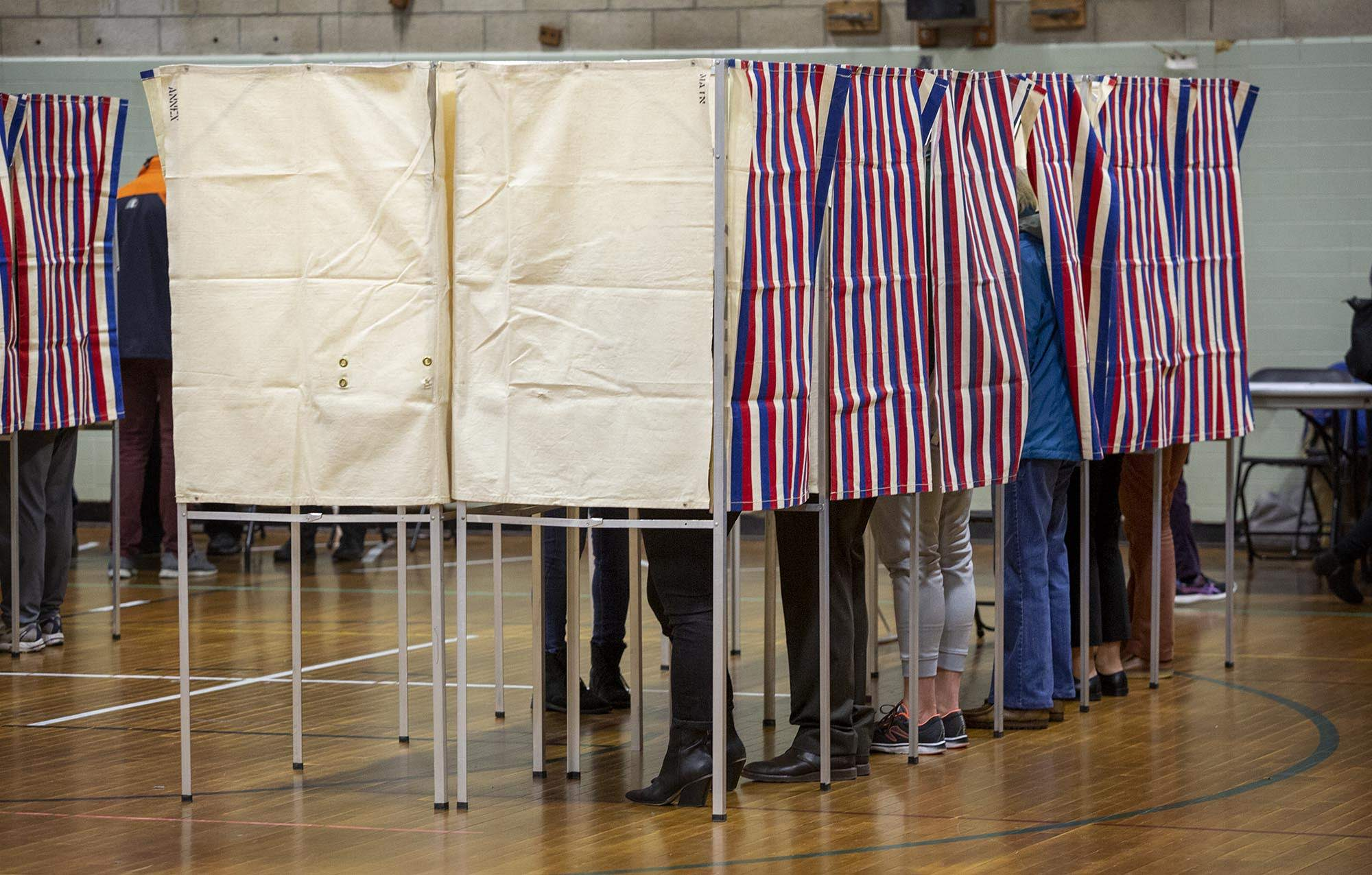 Voters fill the booths at Graham and Parks School in Cambridge, as primary elections get under way in Massachusetts. (Robin Lubbock/WBUR)