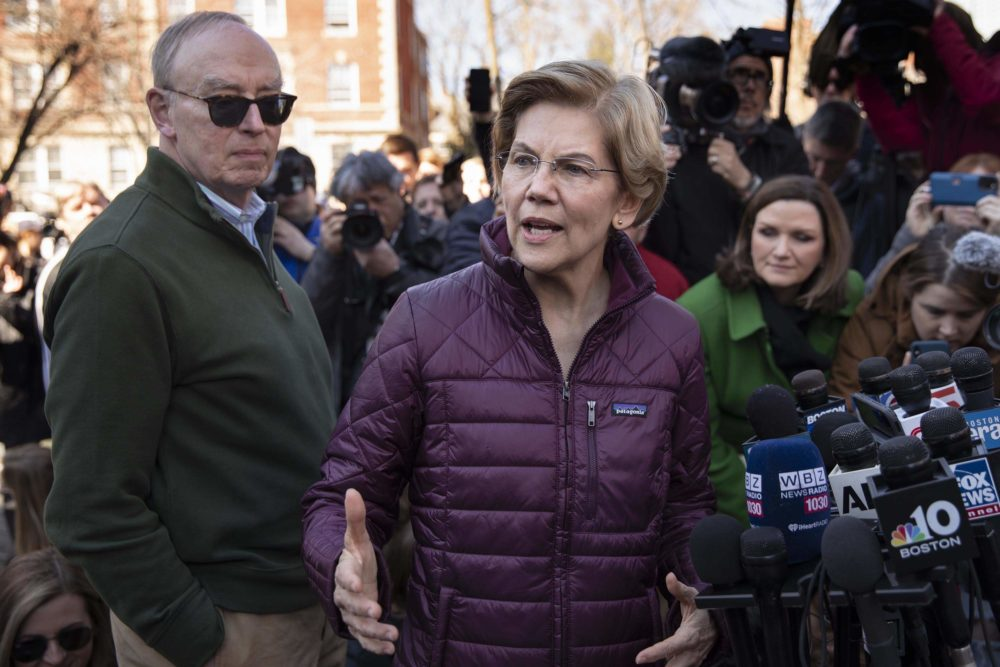Sen. Elizabeth Warren talks to the press after announcing that she was dropping out of the Democratic presidential race. (Robin Lubbock/WBUR)