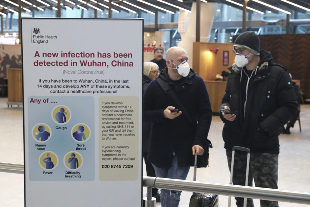 Passengers arrive at Heathrow Airport in London after the last British Airways flight from China touched down in the UK following an announcement that the airline was suspending all flights to and from mainland China with immediate effect amid the escalating coronavirus crisis on Jan. 29, 2020. (Steve Parsons/PA via AP)