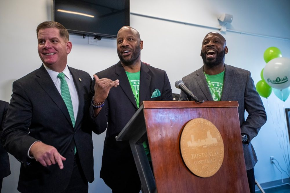 Boston Mayor Marty Walsh, and Pure Oasis co-owners Kobie Evans and Kevin Hart celebrate and announce the opening of the first marijuana dispensary located in Boston. (Jesse Costa/WBUR)