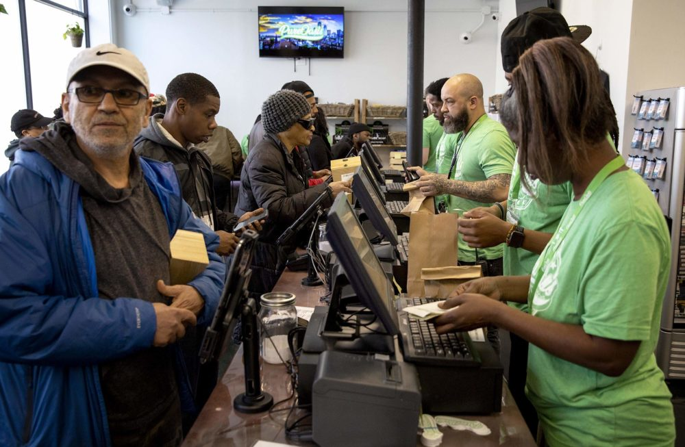 Business gets under way at Pure Oasis on Blue Hill Avenue in Dorchester, the first recreational marijuana store to open in Boston. (Robin Lubbock/WBUR)