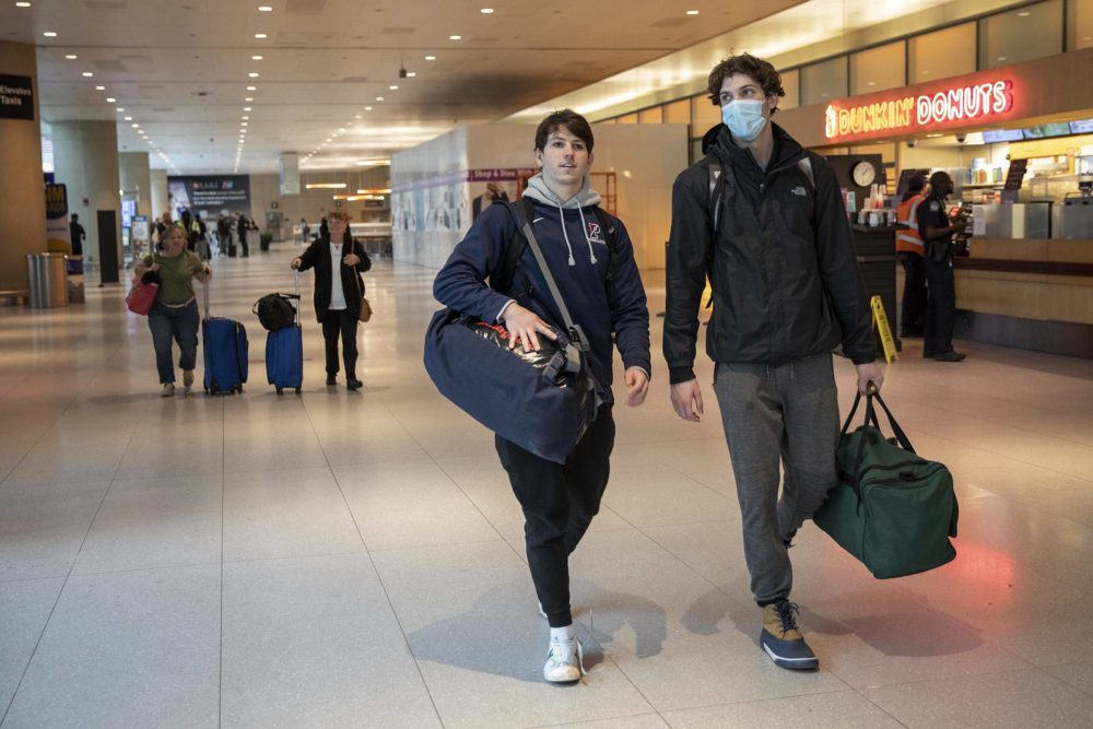 Jack McCaghren and Luke Snyder who study at the University of Pennsylvania, arrive at Logan from Amsterdam. (Robin Lubbock/WBUR)
