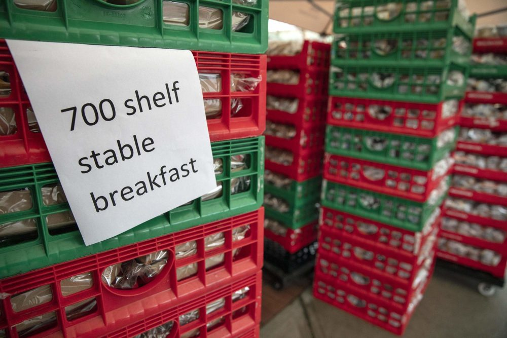 Boston Public Schools positioned 700 school breakfasts and lunches at the YMCA in East Boston for kids to take home if they were not able to attend school. (Robin Lubbock/WBUR)