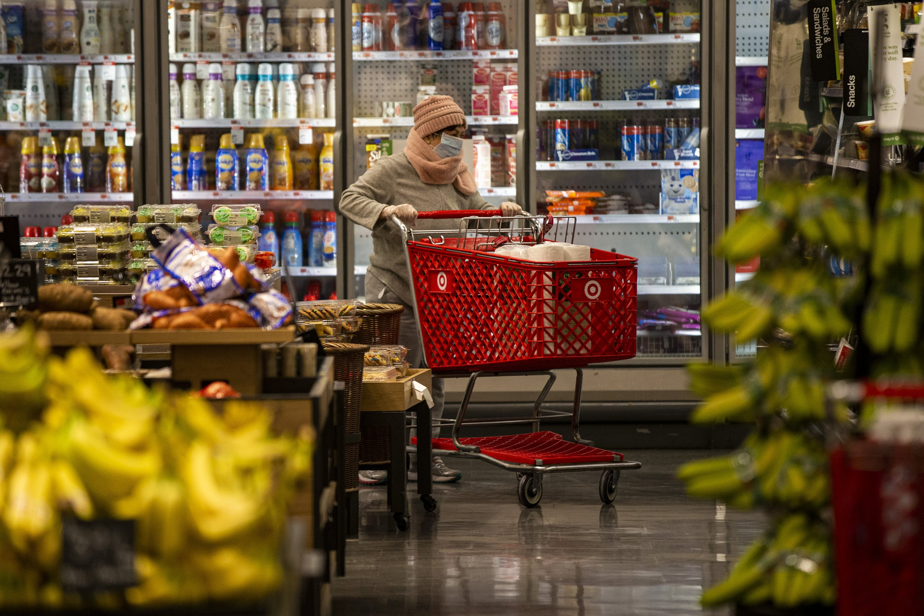 A woman wears a face mask shopping at Target in Watertown. (Jesse Costa/WBUR)