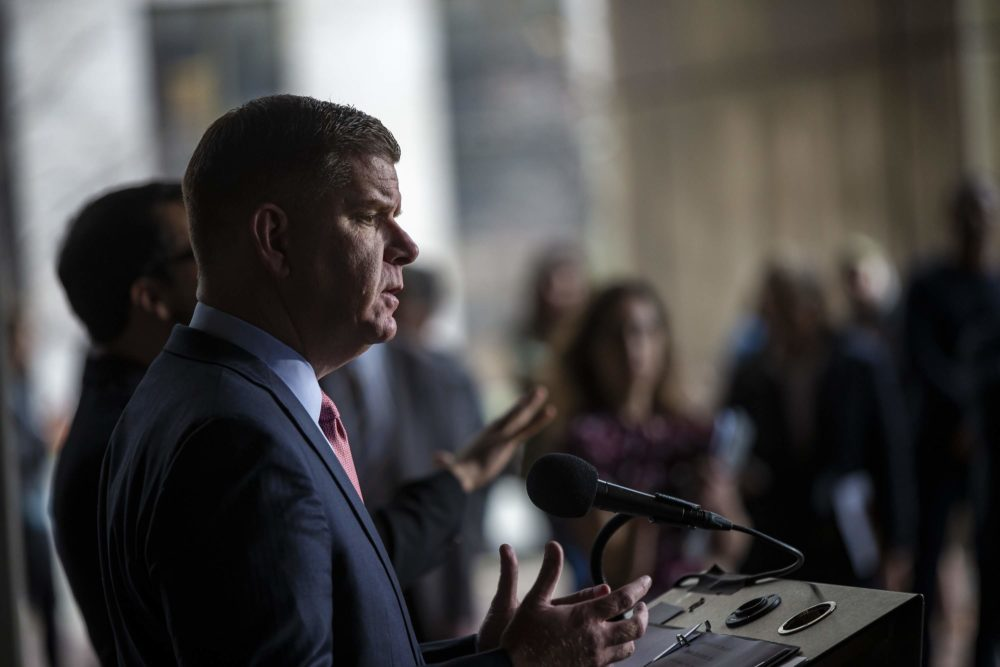 Boston Mayor Marty Walsh addresses the public in front of City Hall Plaza on Friday to give updates relating to COVID-19. (Jesse Costa/WBUR)
