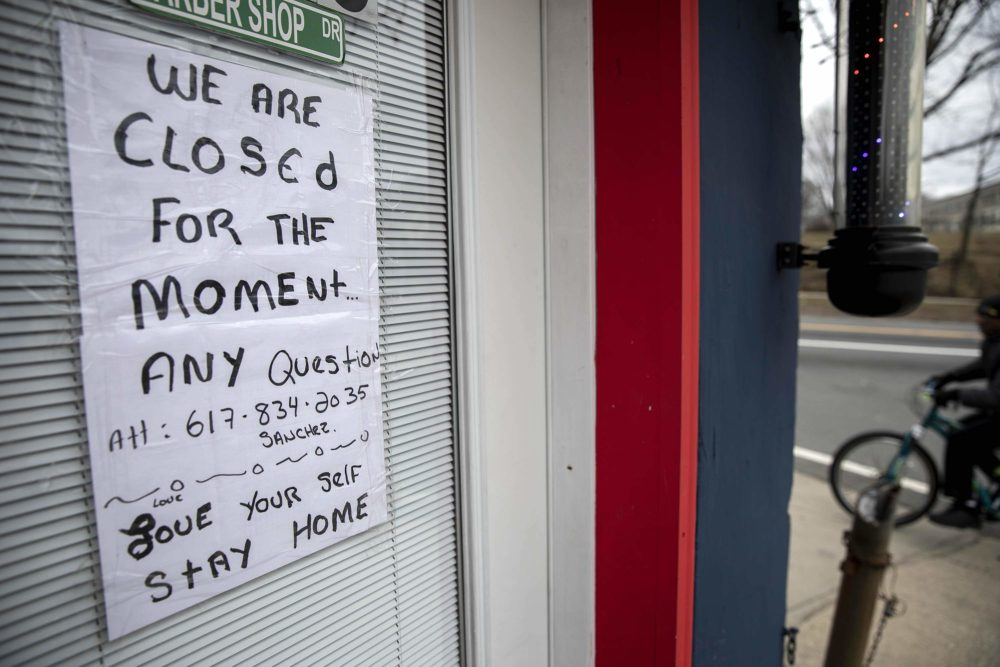 A sign on the door of the Nice Haircut Barber Shop on Dorchester Ave. in Boston. (Robin Lubbock/WBUR)