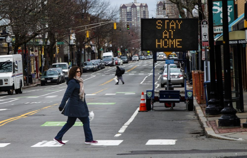 A sign in Inman Square in Cambridge urging residents to stay home during the Coronavirus epidemic, March 25, 2020. (Jesse Costa/WBUR)