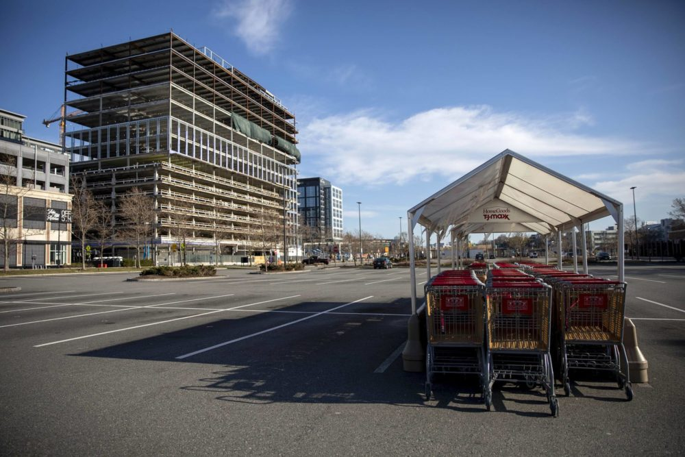 With stores closed and people staying home to slow the spread of the coronavirus, TJ Max carts stand idle in the empty car park in front of the store at Assembly Square. (Robin Lubbock/WBUR)