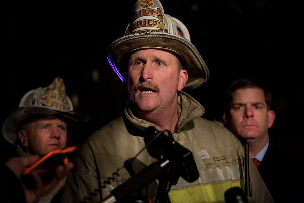 Boston Fire Commissioner Joe Finn speaks at the scene of the Beacon Street fire in 2014. (Jesse Costa/WBUR)
