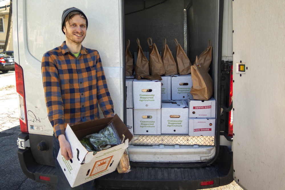 Andrew Lacasse makes deliveries for What Cheer Fruit & Produce, a company that works with small, organic New England growers.  (Andrea Shea/WBUR)