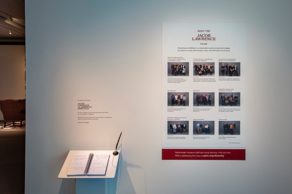 Visitors to the Jacob Lawrence show see a a photo of PEM's staff at the end of the exhibition. (Courtesy PEM)